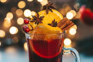Close-up glass of mulled wine on a Christmas background