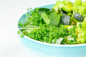 Close-up of a bowl of fresh vegetable salad and watercress (Flip 2020)