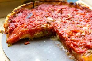Close-up of a cheese and tomato pizza made by Pizzeria Uno: the birthplace of Deep Dish Pizza