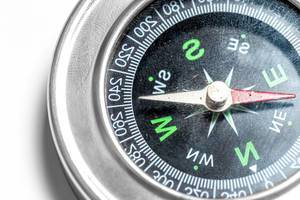 Close-up of a compass on a white background (Flip 2020)