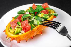 Close-up of a fresh vegetarian salad in half a kiwano (Flip 2020)