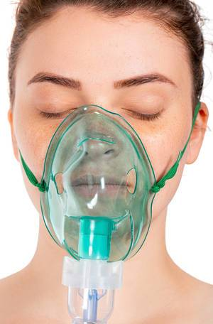 Close up of a girl with a mask for inhalation on her face