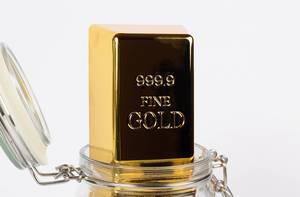 Close up of a gold bar in a glass jar