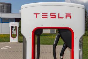 Close-up of a Tesla Supercharger e-charging station