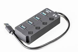 Close-up of black USB hub on white background (Flip 2020)