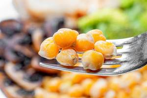 Close up of boiled chickpeas on a fork (Flip 2019)