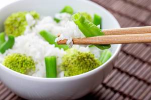 Close up of boiled rice with asparagus and broccoli in a white bowl (Flip 2019)