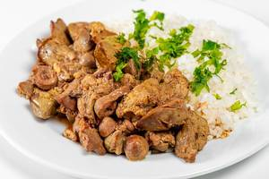 Close up of braised chicken liver with hearts and boiled rice (Flip 2019)