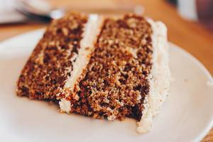 Close up of carrot cake with cream