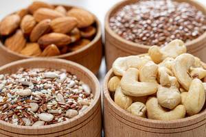 Close-up of cashew nuts, almonds and various seeds in wooden bowls (Flip 2019)