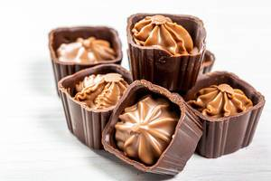 Close-up of chocolate candies with nut cream