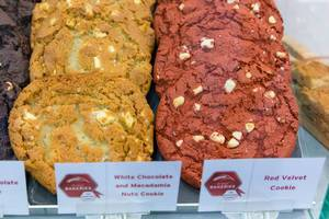 Close-up of colorful red Velvet cookie and white Chocolate and Macadamia Nuts Cookie