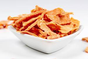 Close- up of dried pumpkin slices in a white bowl