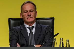 Close-up of executive Director of german soccer team BVB, Hans-Joachim Watzke, with crossed arms at annual general meeting