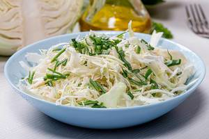 Close - up of fresh cabbage salad with leeks (Flip 2019)