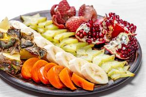Close up of fresh exotic fruit slices on a plate (Flip 2019)