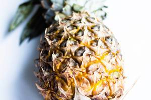 Close up of fresh ripe pineapple on white background