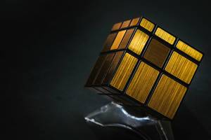 Close up of golden puzzle cube