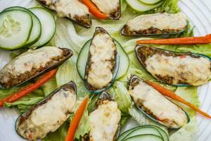 Close up of green shell mussels in cream cheese