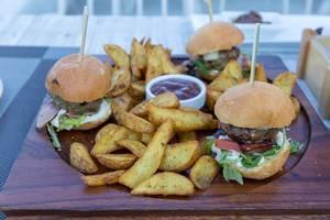 Close-up of hamburgers and roast potatoes at Aelia Restaurant Kassandra