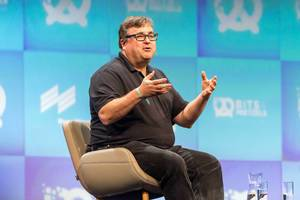 Close-up of Linkedin executive chairman and investor Reid Hoffman talking to international audience at German bits19 festival in Munich