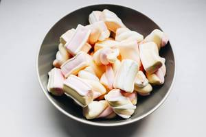 Close up of marshmallows in a grey plate