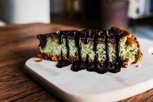 Close up of matcha cheesecake with chocolate fudge (Flip 2019)
