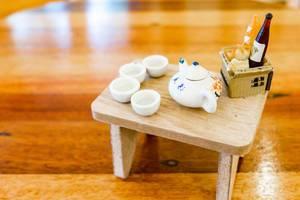 Close up of miniature porcelain set and food basket (Flip 2019)