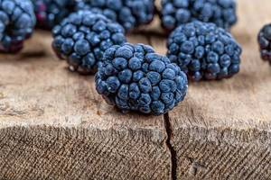 Close-up of mulberry berries on a wooden background