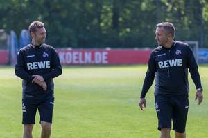 Close-up of new 1. FC Köln German soccer coach duo André Pawlak and Manfred Schmid after their first co-working training session
