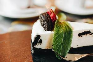 Close up of oreo cake with strawberry and cookie