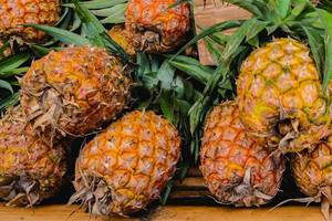 Close up of pineapples on sale