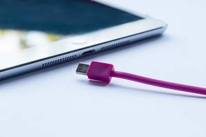 Close-up of pink cable for charging a smartphone or tablet
