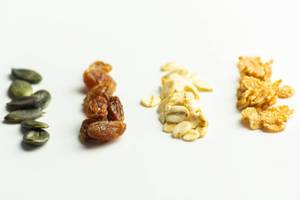 Close-up of pumpkin seeds, resins, oat flakes and corn flakes