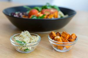 Close-up of quinoa and roasted sweet potatoes in tiny glass bowls