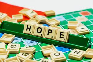 "Close up of ""Hope"" word on scrabble"