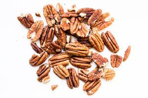 Close up of raw pecan nuts on white background  Flip 2019