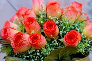Close Up of Red Artificial Roses in Flower Bouquet