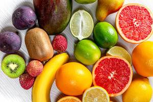 Close - up of ripe fresh fruit background. Top view