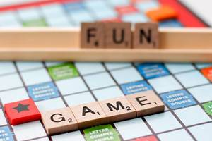 Close Up of Scrabble Board Game with Words Game and Fun