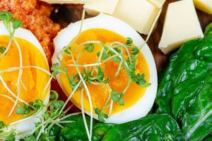 Close- up of sliced boiled eggs with vegetables for Breakfast (Flip 2020)