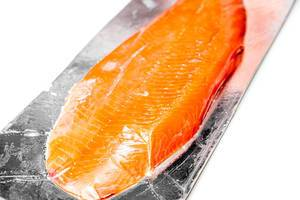 Close-up of smoked red fish fillet on white background (Flip 2020)