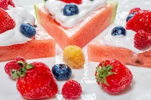 Close-up of strawberries, raspberries, blueberries and watermelon-fruit dessert with cream (Flip 2019)