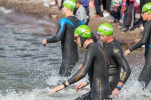 Close-up of the swimmers start for the Ironman 70.3 on the coast of Lahti, in Lake Vesijärvi in the south of Finland