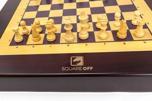 Close-up of the white chess pieces of Square Off, the world