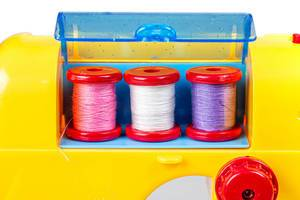 Close up of three spools of thread in a toy sewing machine (Flip 2020)