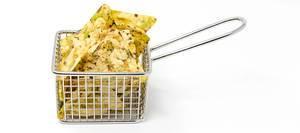 "Close-up of vegan snack ""vaya bean salt snack""-Chips by Zweifel, in a frying basket"