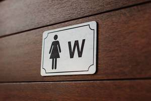 Close up of women bathroom sign