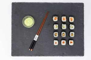 Close Up on Moso-Maki Sushi with Wasabi Dip and traditional Chopsticks