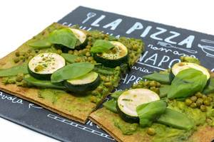 Close Up on the green Lizza - healthy vegan pizza with crust made from chia and flaxseeds